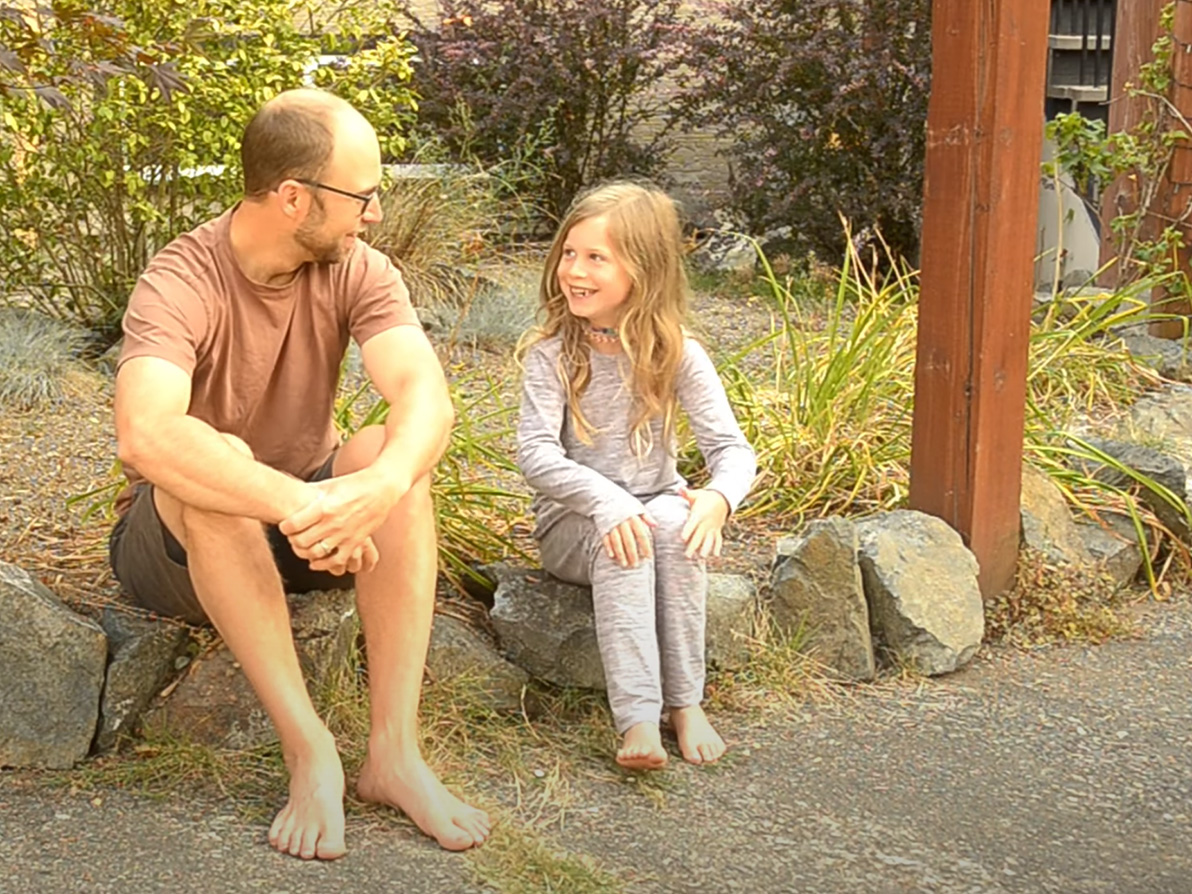 Greg and Eliana barefooting outdoors